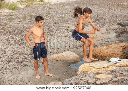 athletes performs freerunning jump on stones