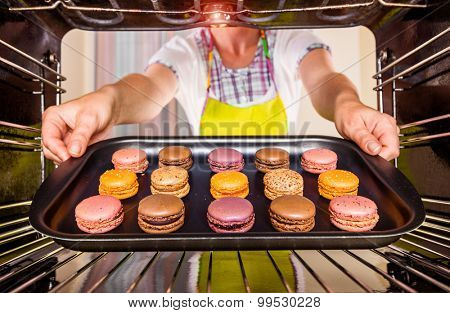 Baking macarons in the oven view from the inside of the oven. Cooking in the oven.