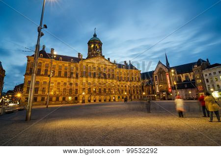Amsterdam, Netherlands - May 7, 2015: Tourist Visit Dam Square in Amsterdam