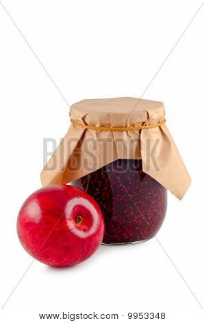 Jam In A Glass Jar With An Apple Isolated White Background.