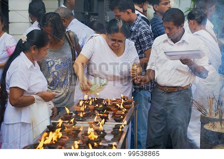 People light candles at a Buddhist temple during Vesak religious celebration in Colombo, Sri Lanka.