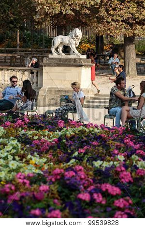 PARIS, FRANCE - SEPTEMBER 8, 2014: People relax in Luxembourg Gardens in Paris France. Luxembourg area is popular among tourists in Paris the most visited city worldwide.