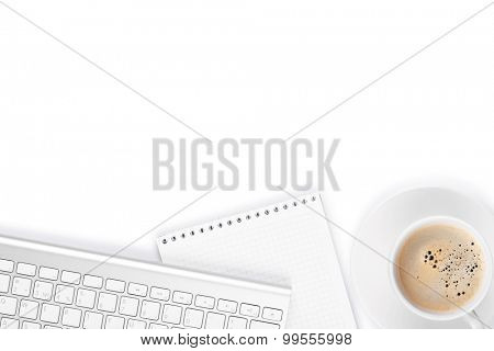 Office desk table with computer, supplies and coffee cup. Isolated on white background