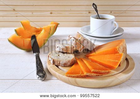 French Cheese, Bread,  Melon And Cup Of Coffee