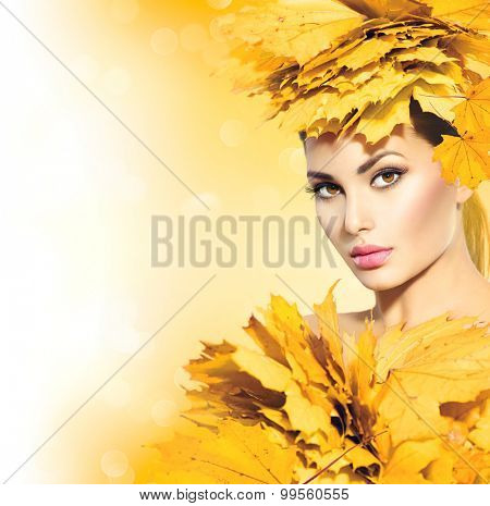 Autumn woman with yellow leaves hair style. Autumn Lady Portrait. Beauty Fashion Art Model Girl with Autumnal Make up and Hairstyle. Fall. Creative Autumn Makeup. Beautiful Face