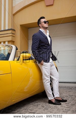 Stylish Man Posing With Convertible Sportcar