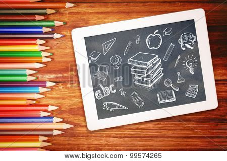 Education doodles against students desk with tablet pc