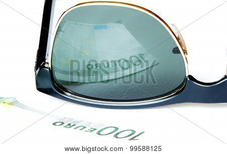 One Hundred Euro Reflected In Sunglasses