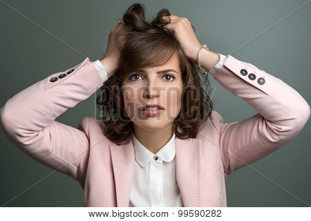Attractive Young Woman Tearing At Her Hair