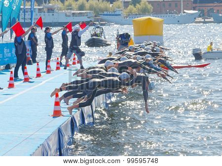The Woman Competitors Jump Into The Water