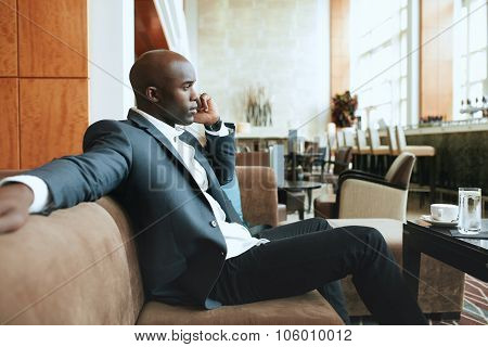 Young Businessman At Hotel Lobby Making A Phone Call