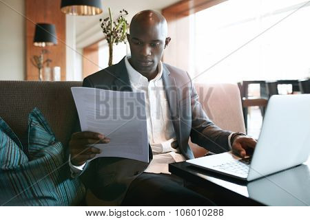 Businessman At Cafe Preparing Himself For A Meeting