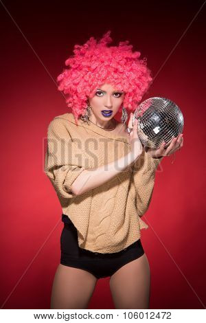 Pink party girl holding silver ball