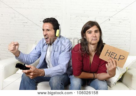 Woman Asking For Help Angry Upset While Husband Or Boyfriend Plays Videogames Ignoring Her