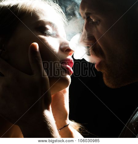 Man Puffing Smoke Into Face