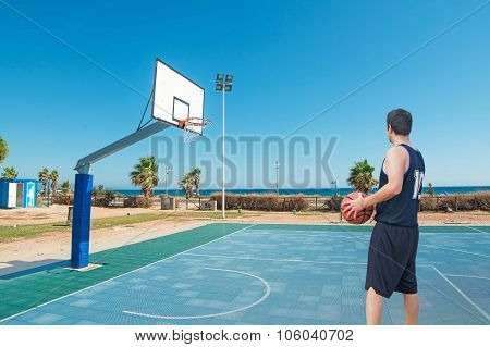 Player Standing In A Blue Playground