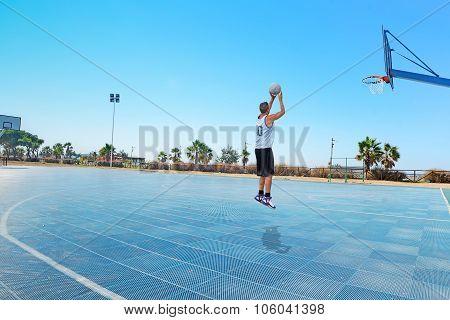 Jump Shot In A Blue Playground