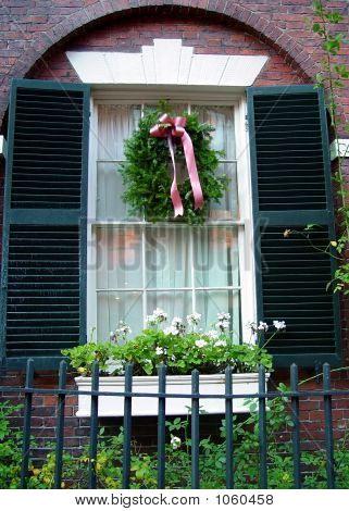 Beautiful Arched Window Frame With Shutters And Christmas Wreath
