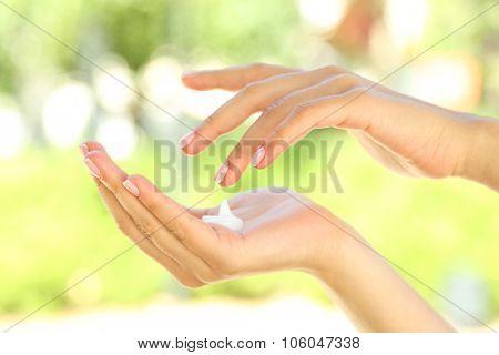 Drop of hand cream on female's hand