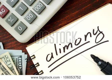 Notepad with alimony concept.