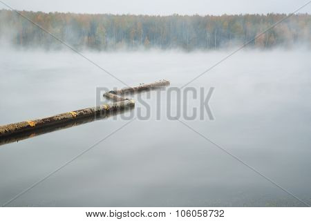 The Mist Over The River In The Autumn Cloudy Day
