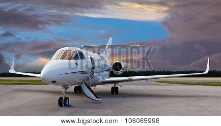 Private jet on the runway with the stair down