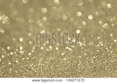 Silver and golden glittering Christmas lights. Gold sparkling Blurred abstract background