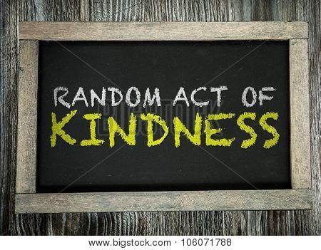 Random Act of Kindness written on chalkboard
