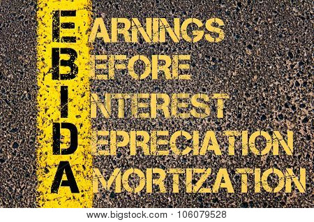 Concept image of Business Acronym EBIDA as EARNINGS BEFORE INTEREST DEPRECIATION AND AMORTIZATION written over road marking yellow paint line. poster
