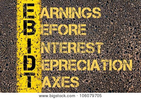 Concept image of Business Acronym EBIDT as EARNINGS BEFORE INTEREST DEPRECIATION AND TAXES written over road marking yellow paint line. poster