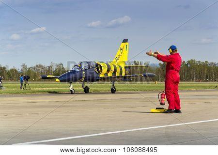 HRADEC KRALOVE CZECH REPUBLIC - SEPTEMBER 5: Baltic Bees Jet Team L-39 Albatros planes rolling on runway at Czech international air festival on September 5 2015 in Hradec Kralove Czech republic. poster