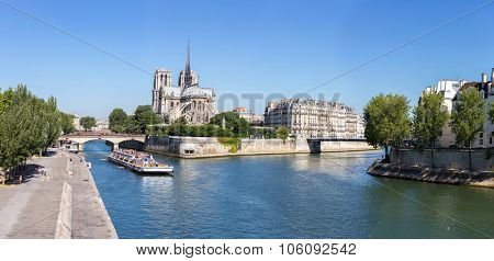 PARIS - JUNE 21: Unidentified tourists riding cruise in River Seine at Cathedral Notre Dame. Notre-Dame, is a historic Catholic cathedral, now one of Paris's primary tourist destinations.