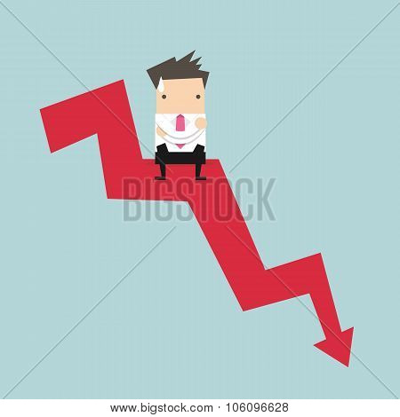 Businessman sitting on graph down