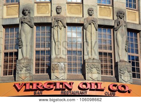 Statue in front Virgin Oil Co
