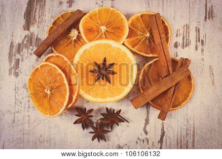 Vintage Photo, Dried And Fresh Orange With Spices On Old Wooden Background