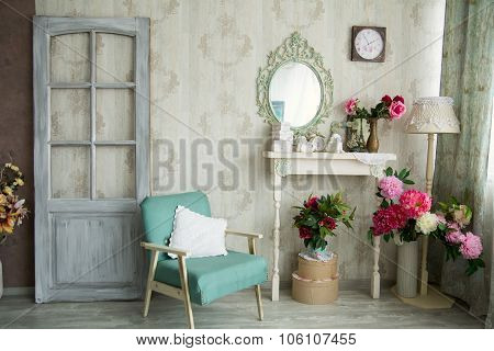 Vintage Country House Interior With Mirror And A Table With A Vase And Flovers