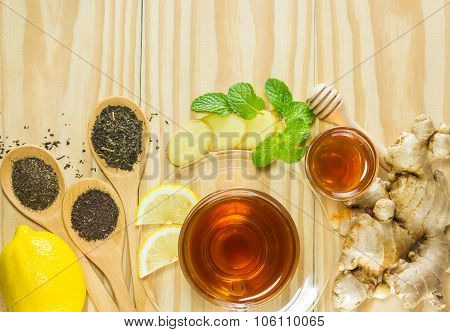 tea with mint honey ginger and lemon on wood backgroundwarm toning selective focus poster