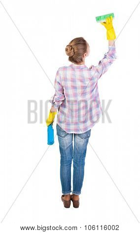 Back view of a housewife in gloves with sponge and detergent. girl  watching. Rear view people collection.  backside view of person.  Isolated over white background. Housewife washes the ceiling.