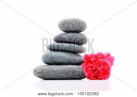 Zen And Spa Stone With Hibiscus Flower Over White Background