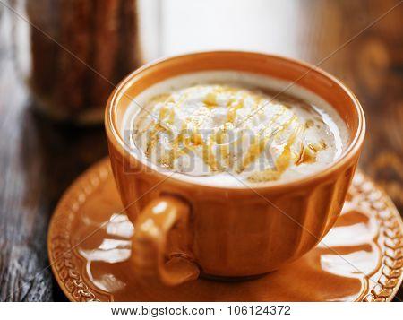 caramel pumpkin spice latte with cream
