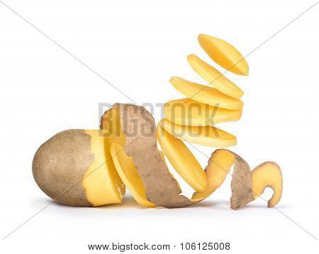 Pieces Of Potato Falling In The Air From Potatoes Peeled Potatoes With The Skin As A Spiral On White
