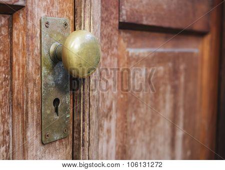 Old Doorknob With Keyhole On Wooden Door