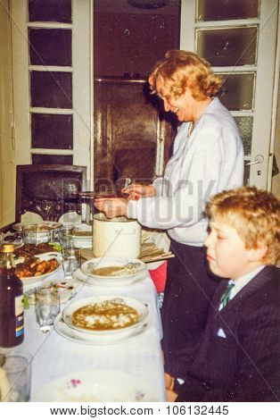 LODZ, POLAND, CIRCA 1988: Vintage photo of grandaunt and a little boy during a Christmas party