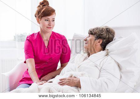 Nurse And Geriatric Ward Patient