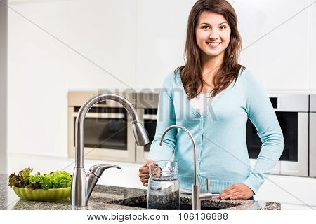 Woman Pouring Tap Water