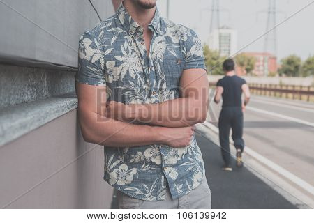 Detail Of A Young Handsome Man Posing In The Street