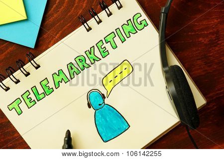 Notepad with telemarketing concept.