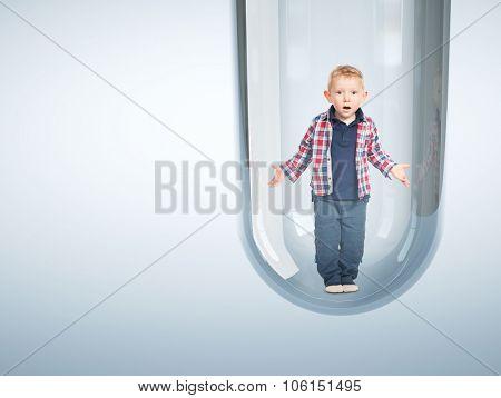 surprised child and tube vitro glass