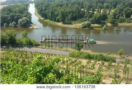The tugboat near confluence rivers Vltava and Elbe