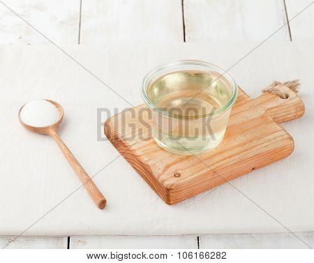 Sugar syrup in glass bowl on a white background